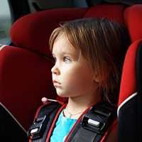 used-girl-in-car-seat-head-rest-secondary-433374